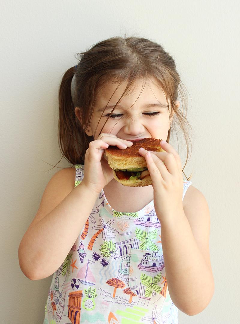 Enjoying a delicious ABC sandwich.