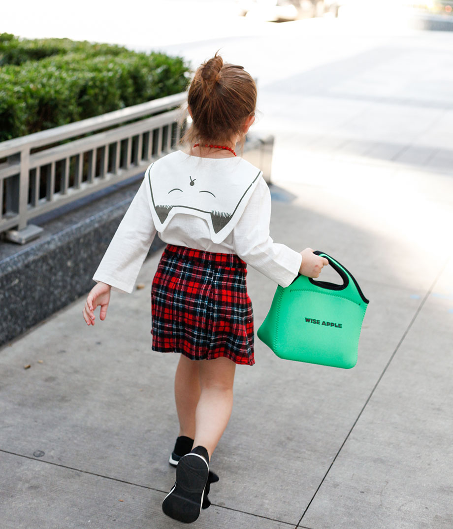 An adorable back to school toddler outfit with a plaid skirt and a kitty top.