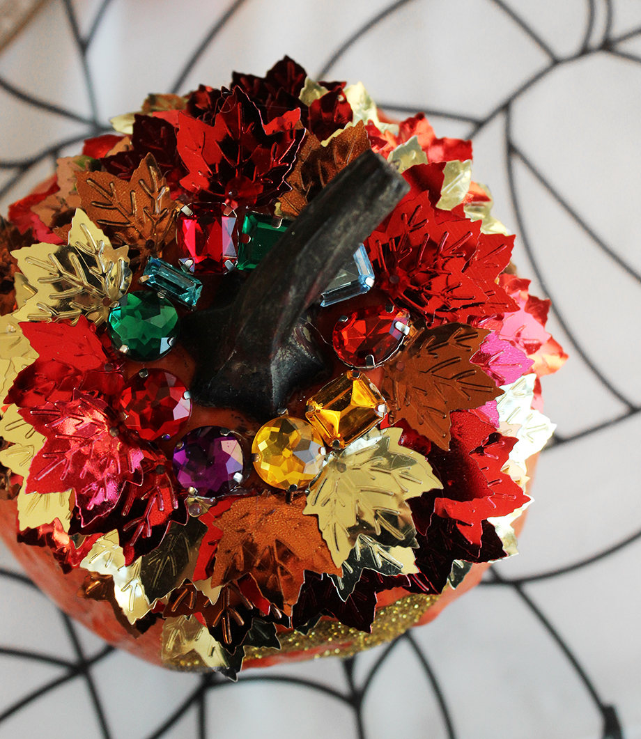 How to put metallic leaves on a pumpkin.