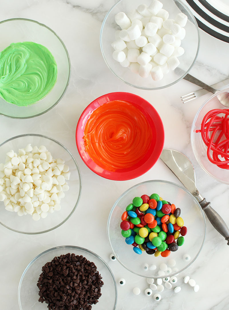 Colorful frosting and candy to decorate the scary monster cookies.