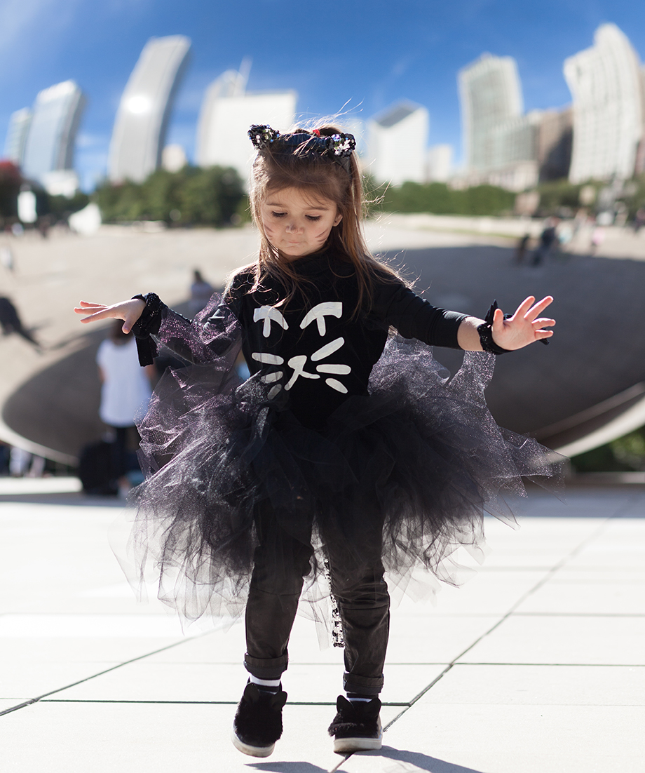 A toddler wearing a sparkle kitty costume from Redeux Kidz.
