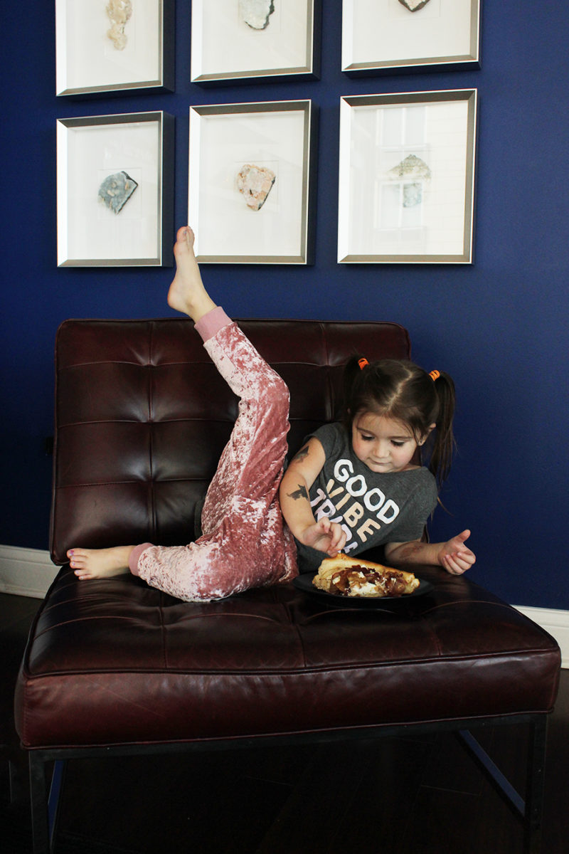 A toddler eating pizza.