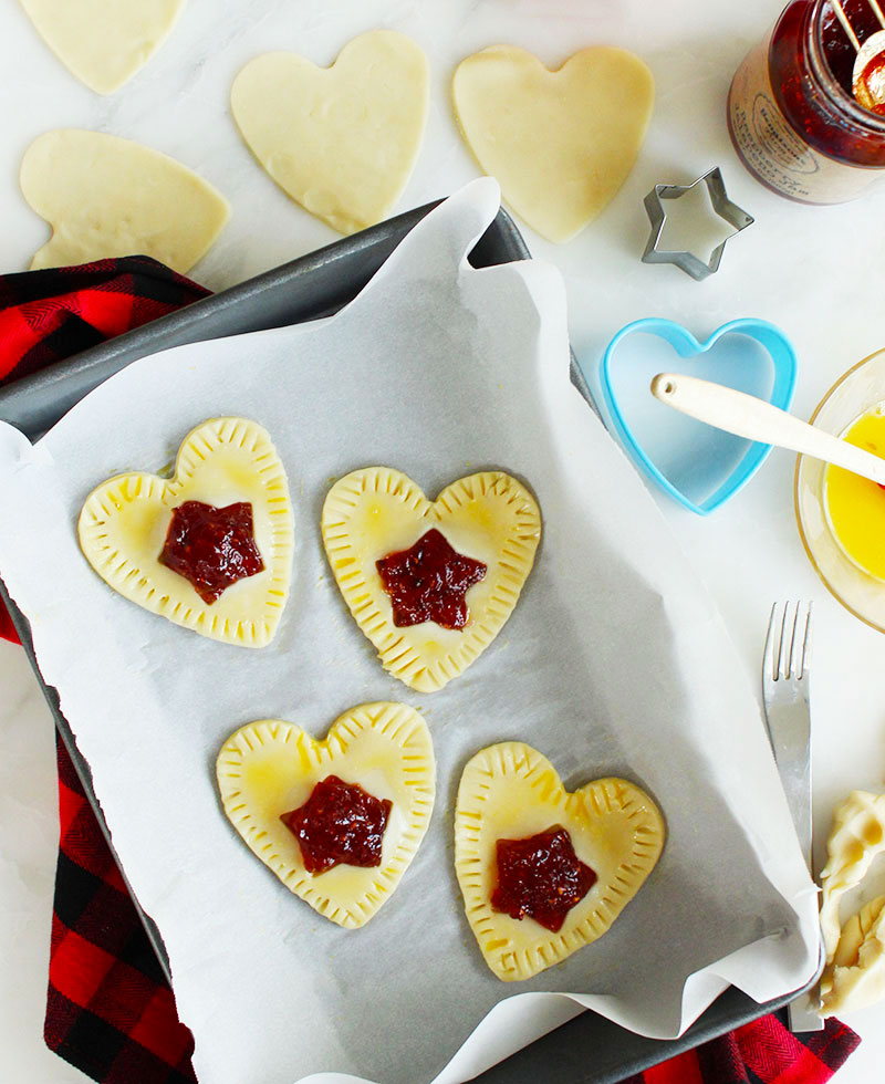 Baking pop hearts with children.