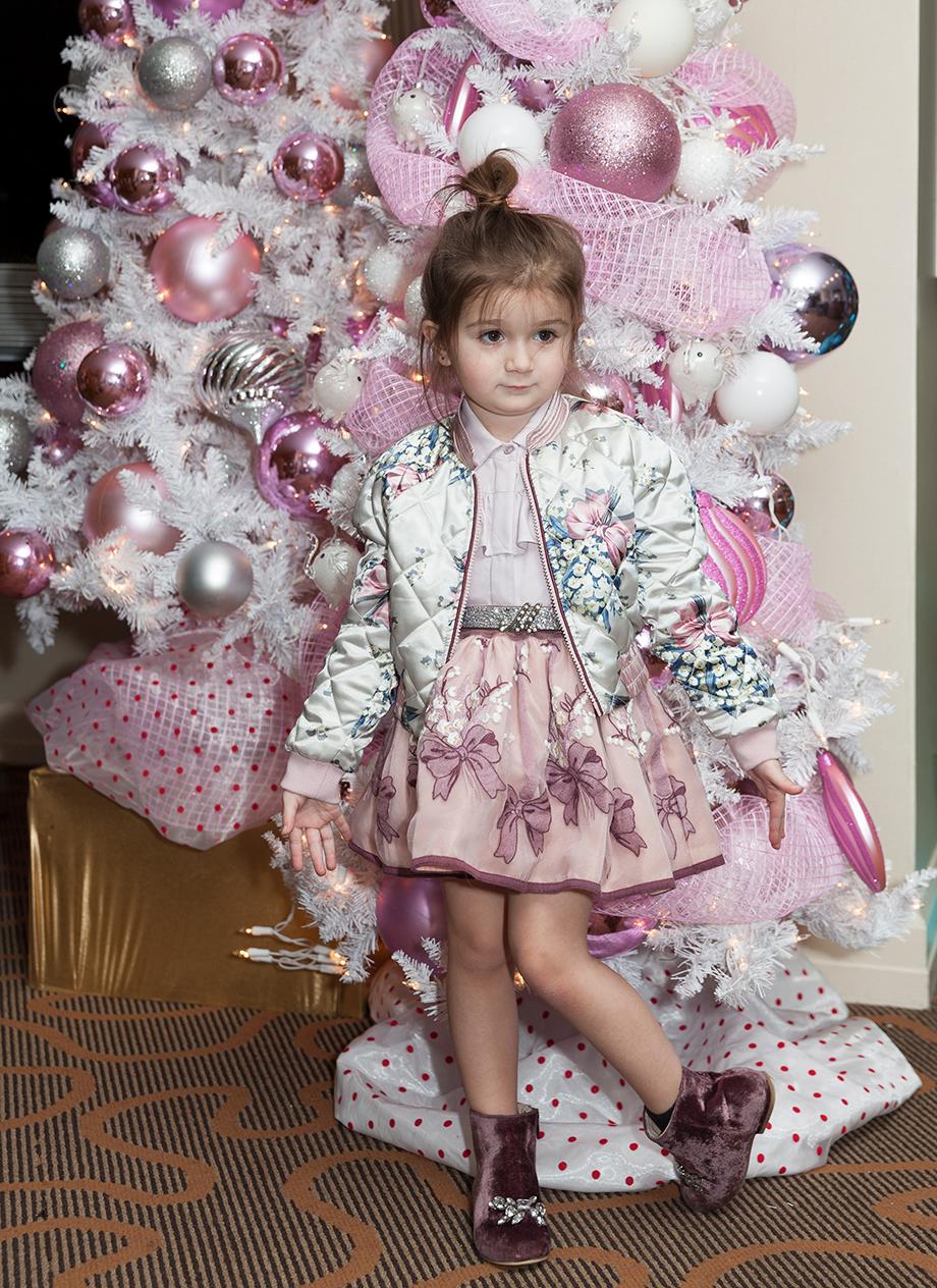 A little girl wearing Monnalisa Kids.
