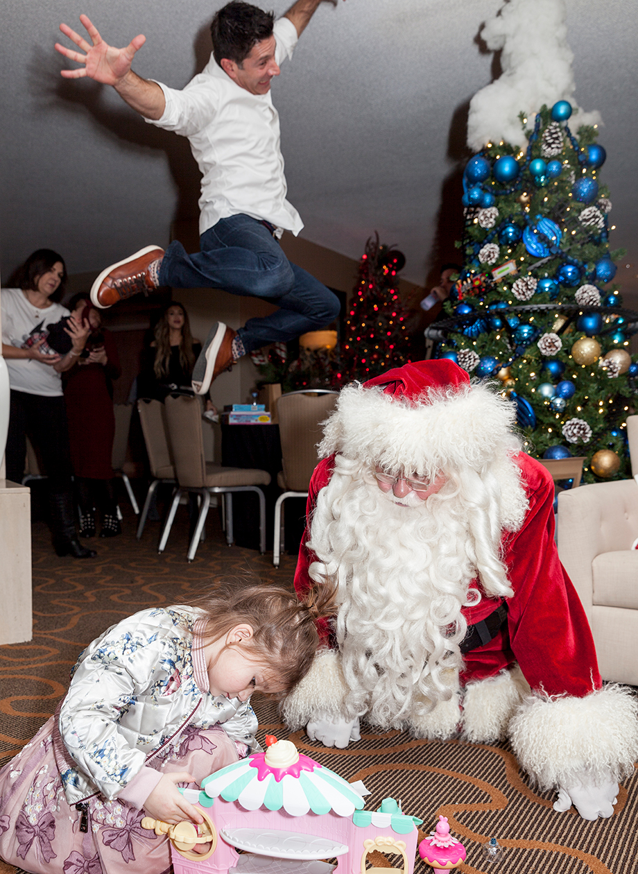 A little girl plays with Santa at the Swissotel Chicago.
