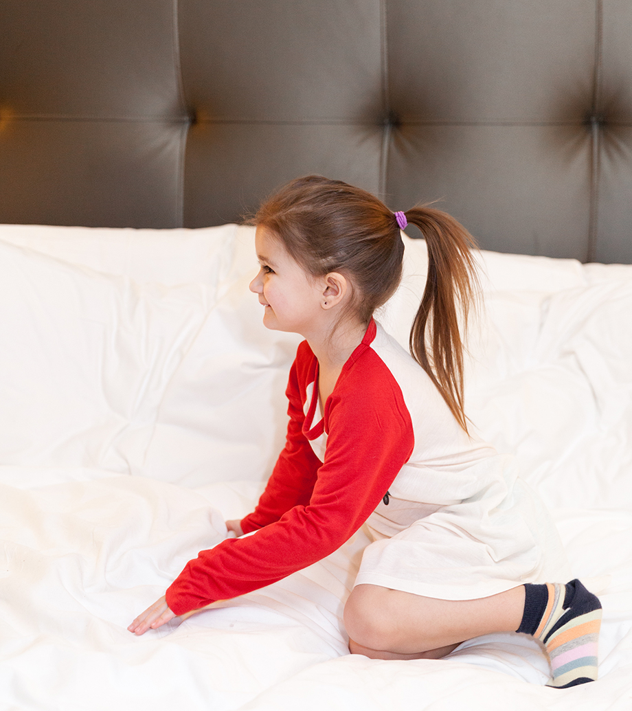 A little girl at the Waldorf in pajamas.