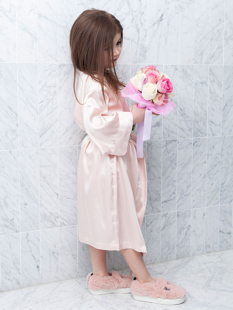 A pink satin flower girl robe.