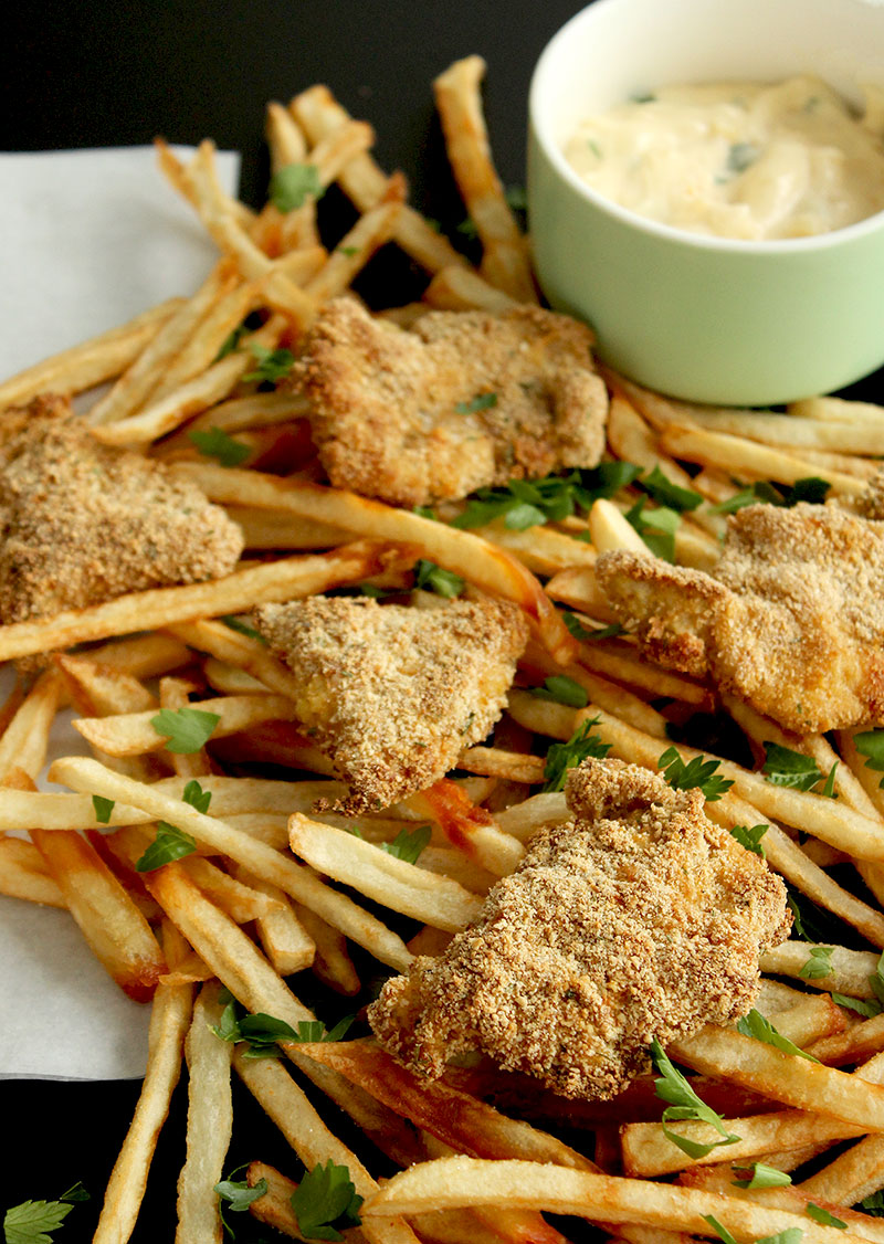 Mini chicken schnitzels are paired with skinny French fries in this delicious recipe by Glitter and Bubbles.