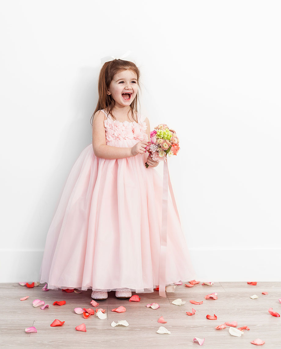 A gorgeous pink flower girl dress from David's Bridal.