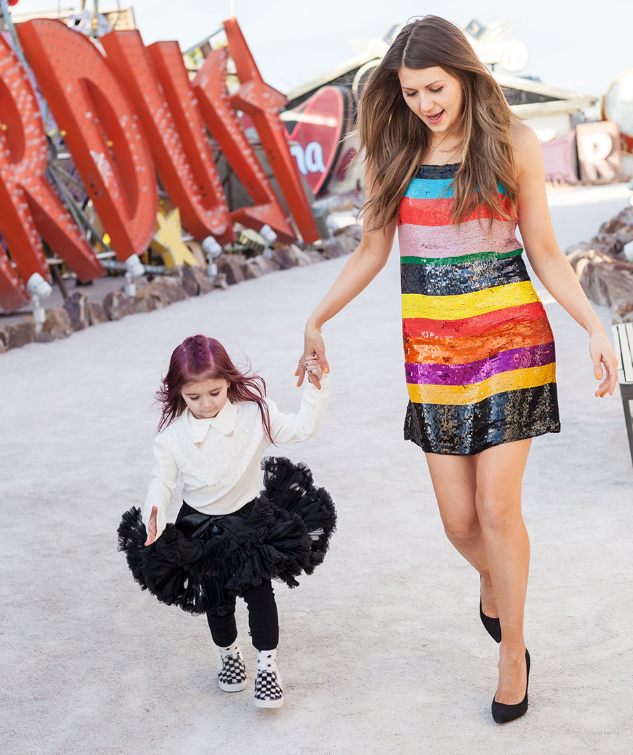 A stylish mother daughter duo shows off their street style at the Neon Museum in Las Vegas.