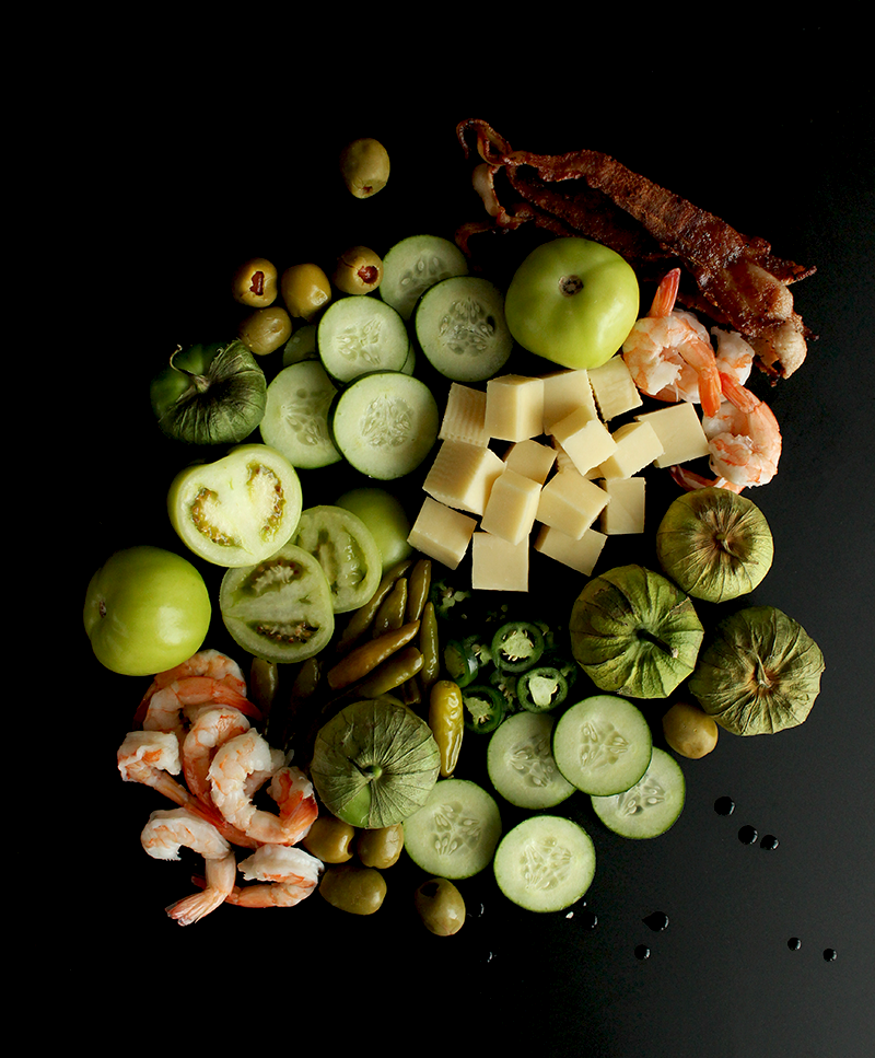 A collection of ingredients needed to make Green Bloody Mary's for St. Patrick's Day.