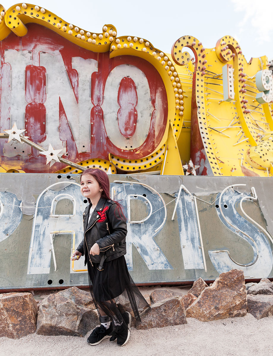 A toddler shows off her all black street style at the Neon Museum in Las Vegas.