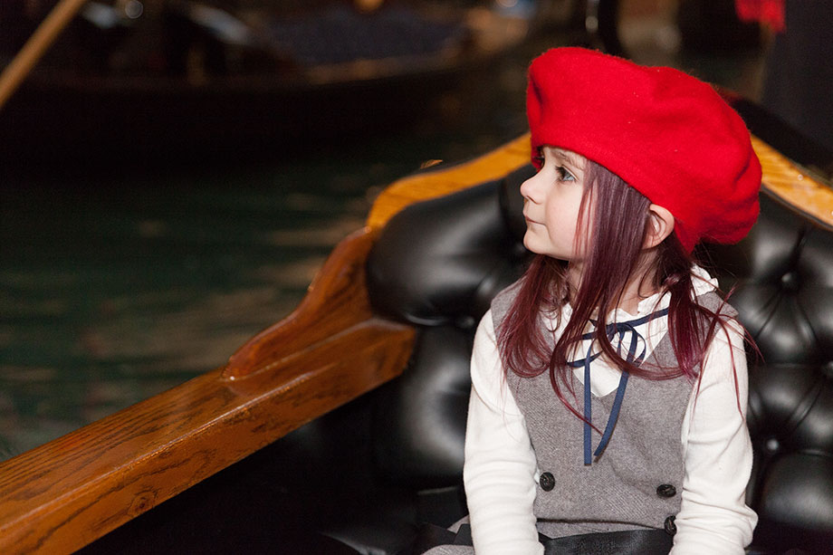 A toddler wears a red hat the Ventian in Las Vegas.