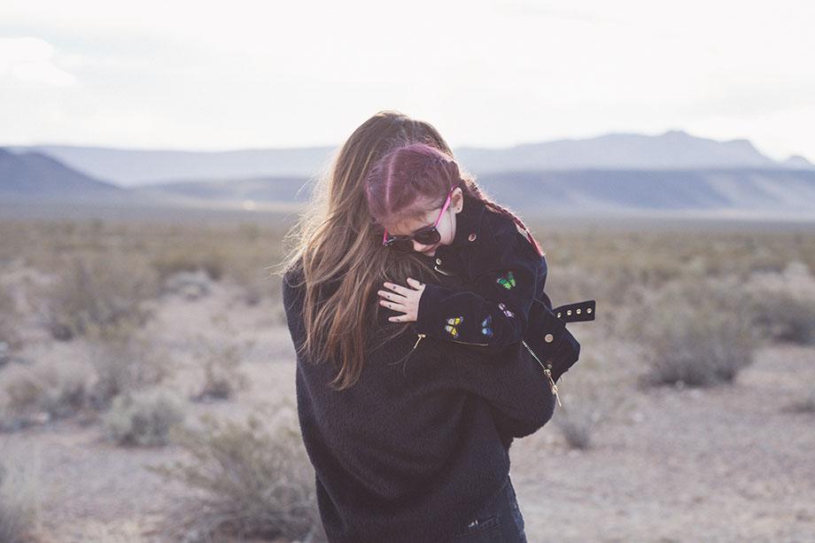 Corri McFadden holds daughter, Zelda in the desert in Las Vegas.