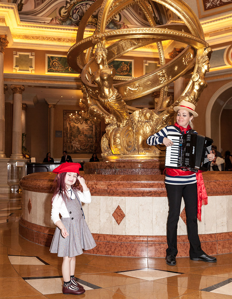 Zelda of Glitter and Bubbles wears a red hat at the Venetian in Las Vegas.