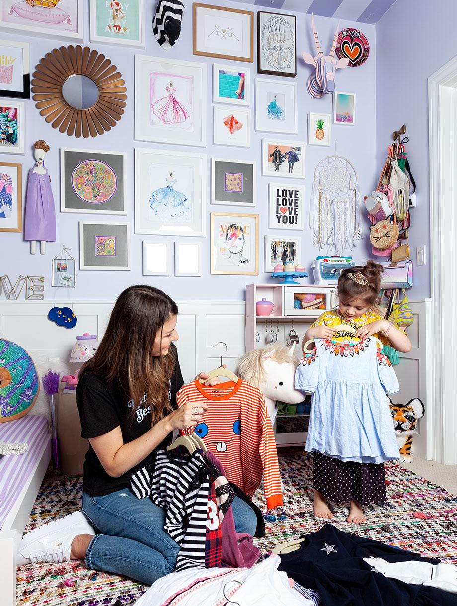 Mom and daughter, Corri McFadden and Zelda, clean out Zelda's closet.