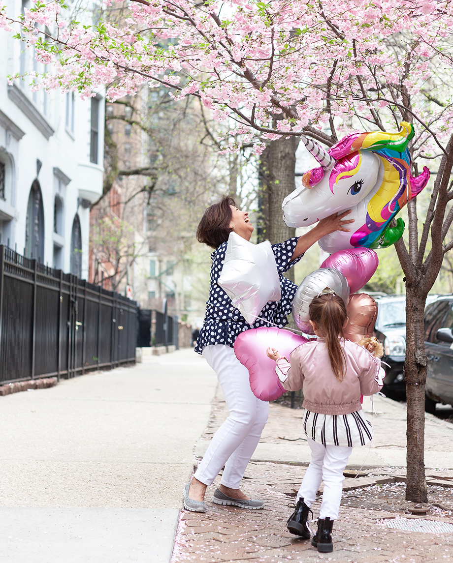 Zelda of Glitter and Bubbles stands on the sidewalk with her nanny in Chicago.