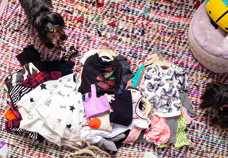 A mother daughter duo cleans out a kid's closet.