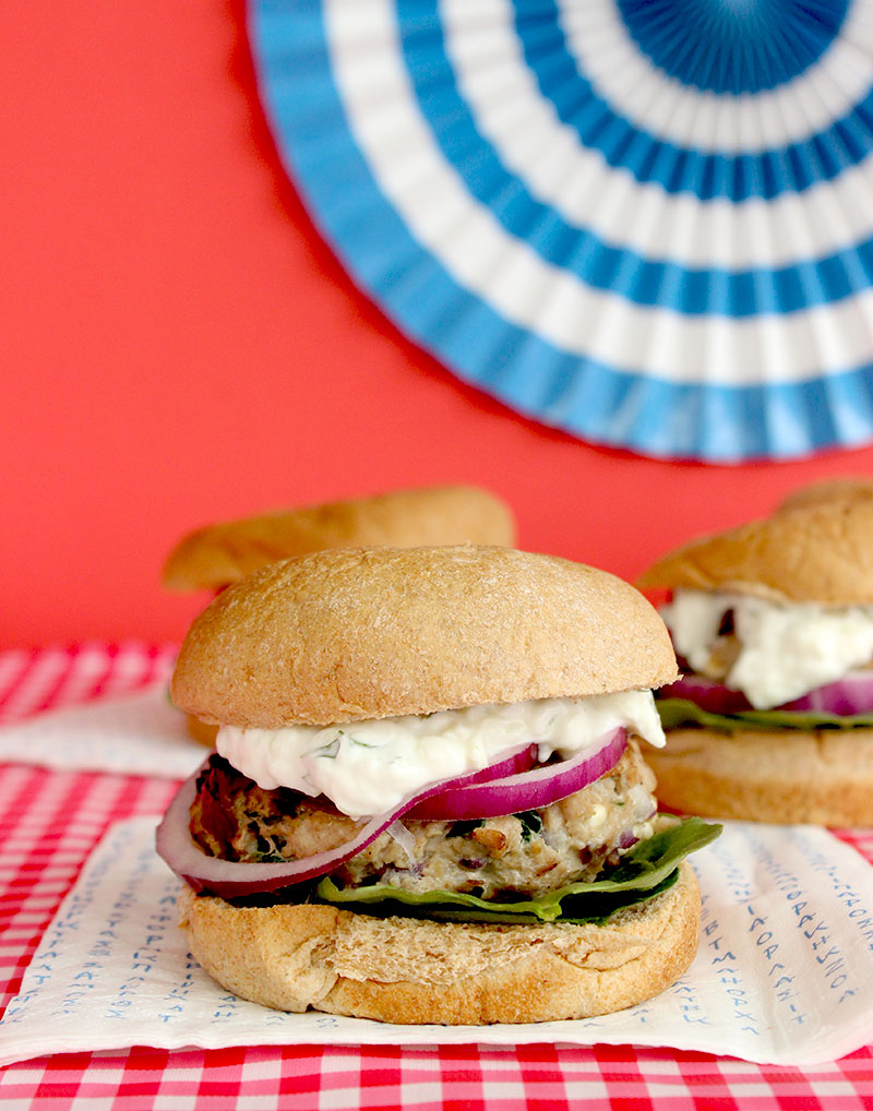 A simple recipe for Greek Turkey Burgers with homemade tzatziki sauce on Glitter and Bubbles for the 4th of July.