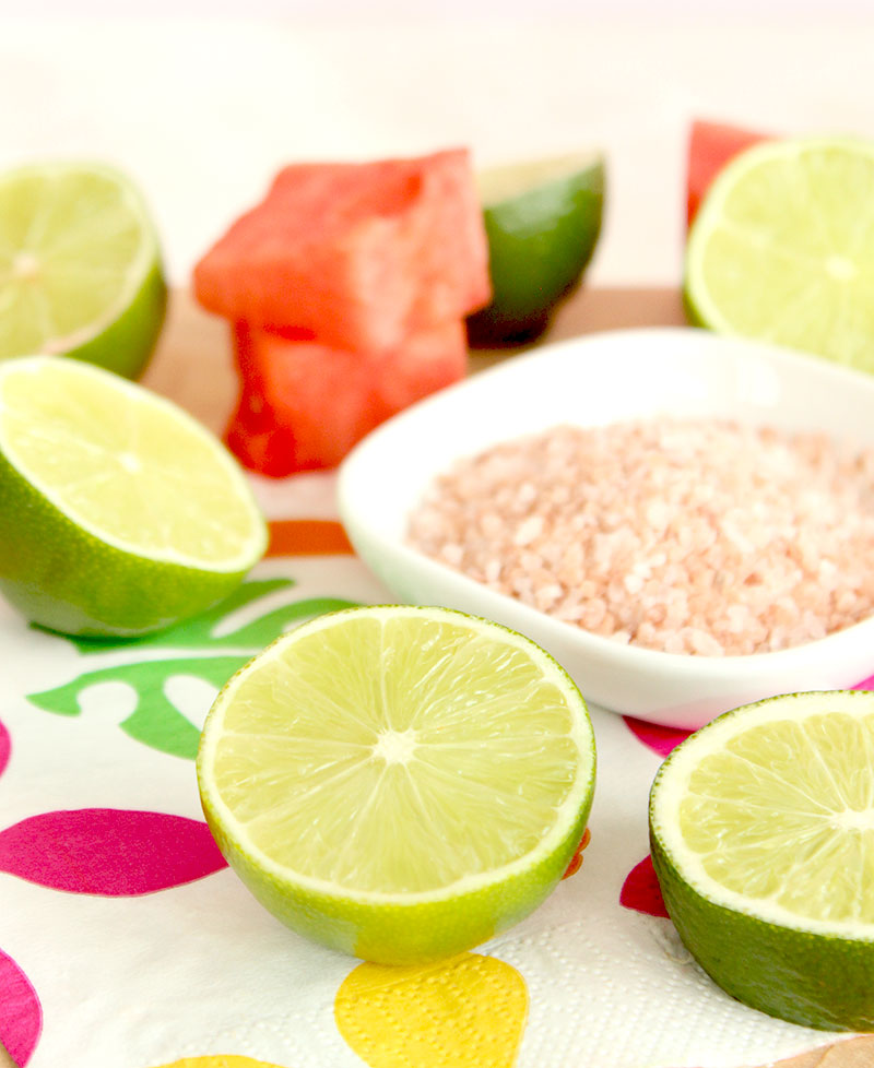 Pink sea salt and limes for a delicious margarita recipe.