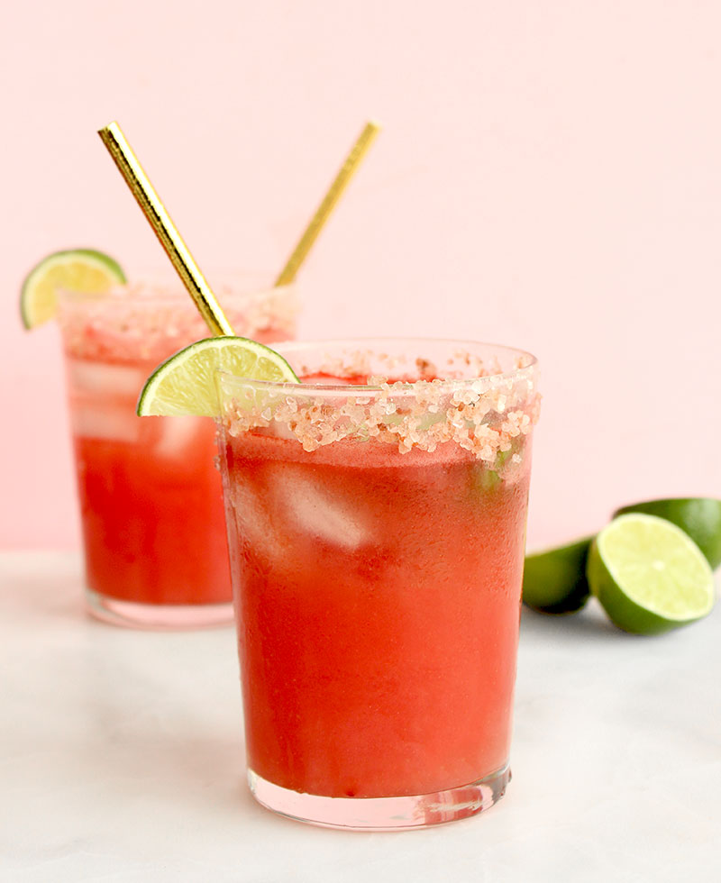 Sea salt pink margaritas with watermelon and lime on Glitter and Bubbles.