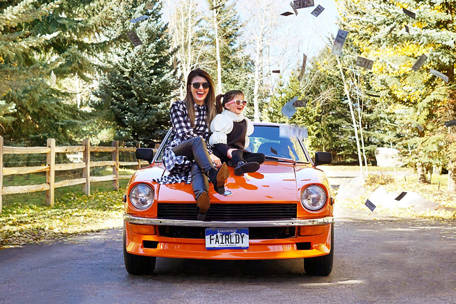 Corri McFadden and her daughter Zelda sit on top a car and talk to readers about how to purchase a new car.