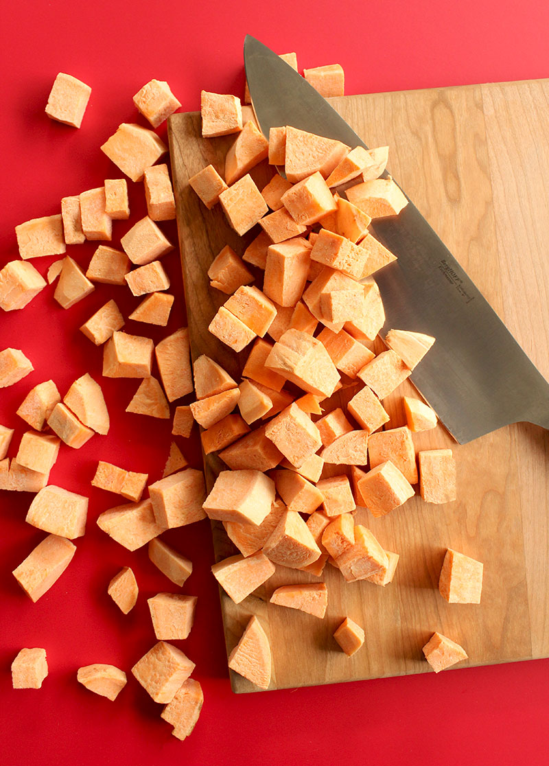 Chopping sweet potatoes for Thanksgiving.