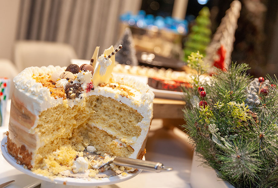 The Christmas cake is eaten at the Swissotel Santa Suite.