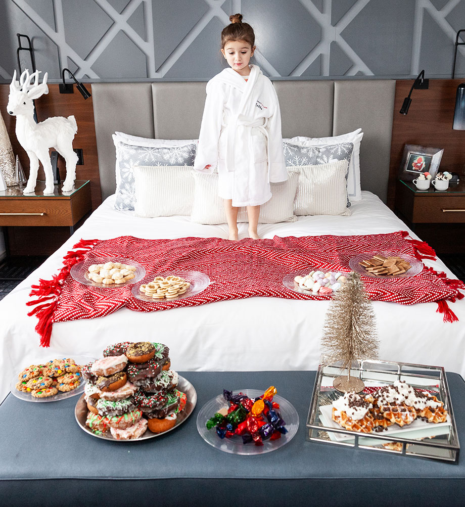 Zelda gets ready to eat breakfast in bed at the Swissotel.