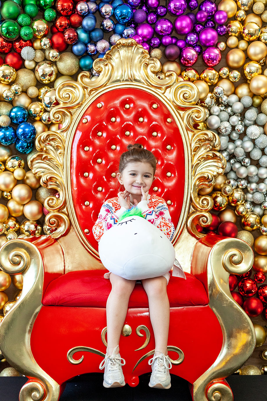 Zelda sits in Santa's chair on Christmas morning in the Swissotel.