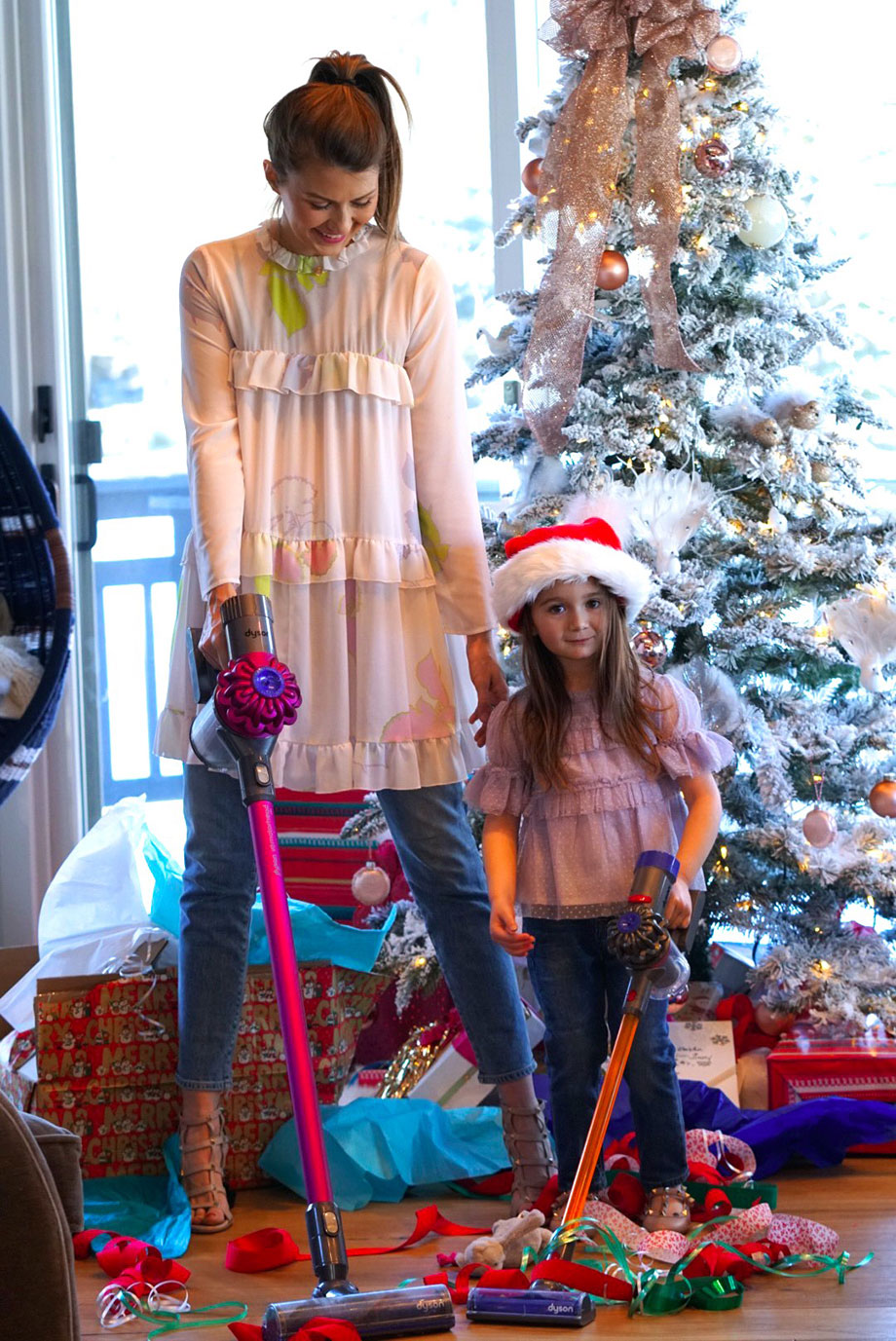 Corri McFadden and her daughter Zelda show off the perfect Christmas gift idea, a Dyson vacuum!