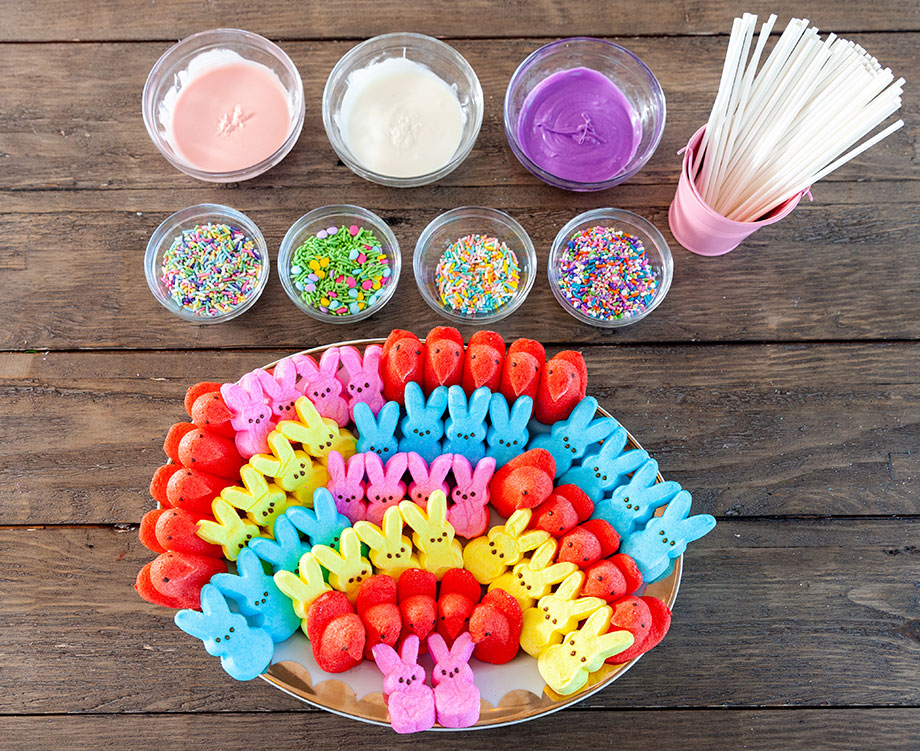 A table filled with frosting and peep ingredients.