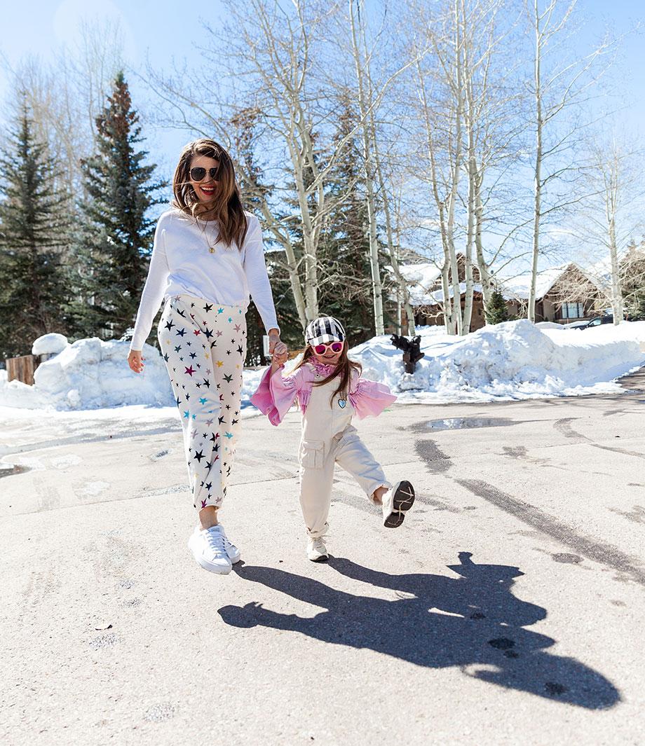 Corri McFadden wears star print sweatpants in Aspen on Glitter and Bubbles.