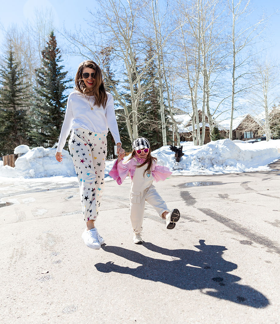 Corri McFadden wears star print sweatpants in Aspen on Glitter and Bubbles.