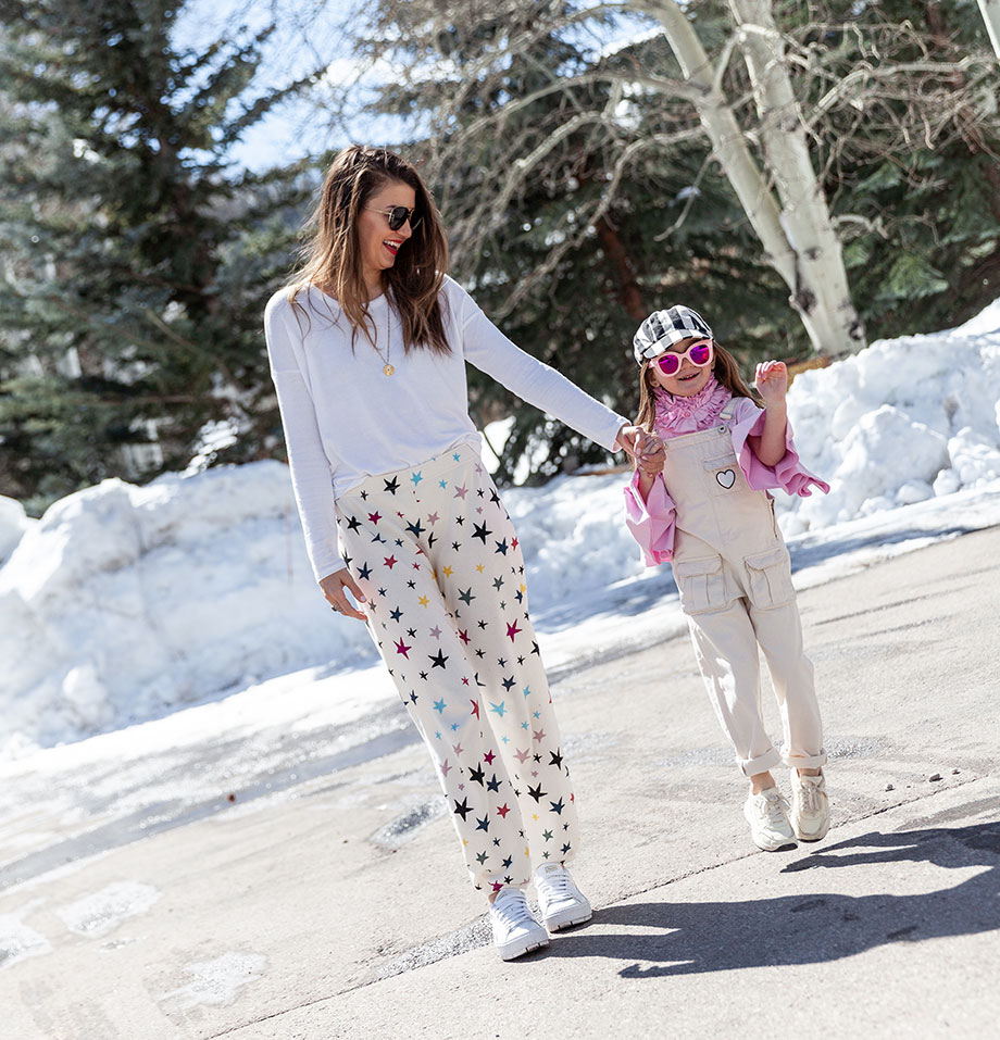 Corri McFadden of Glitter and Bubbles shows off star print sweatpants with her daughter Zelda on Glitter and Bubbles.