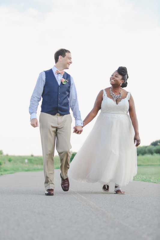 bride and groom looking smiling