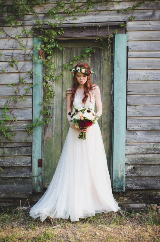 bride in front of rustic shed