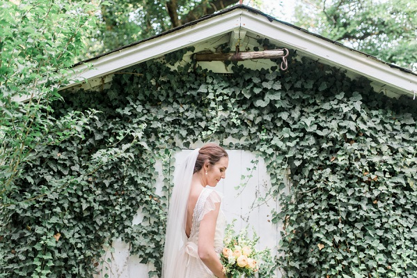 bride in front of ivy shed