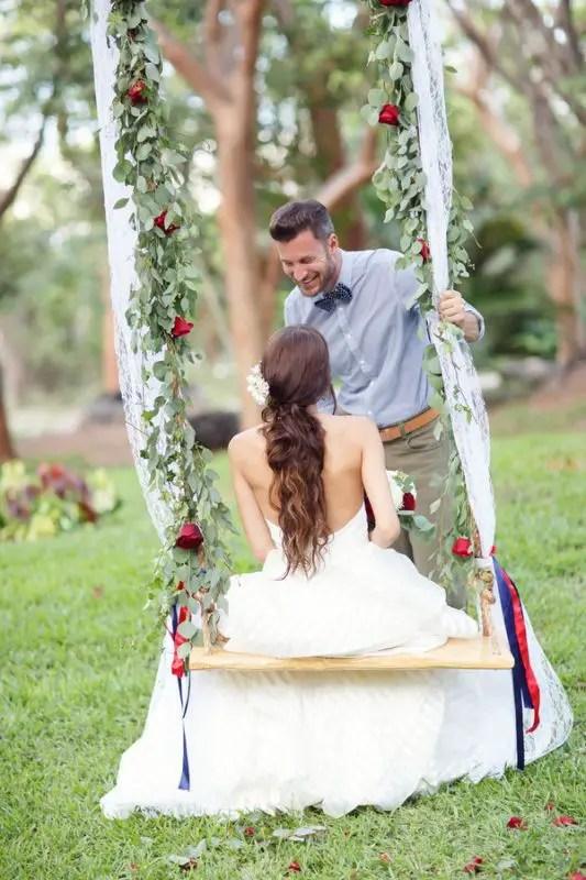 groom looking at bride on swing