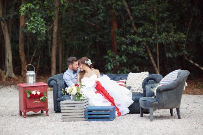 bride and groom on couch
