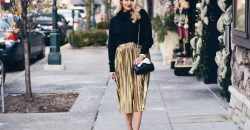 gold pleated midi skirt with black sweater