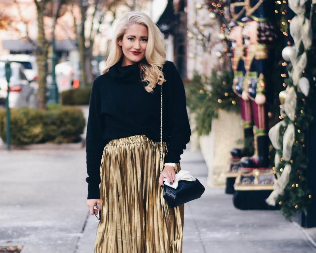 gold pleated midi skirt with black cowl neck sweater