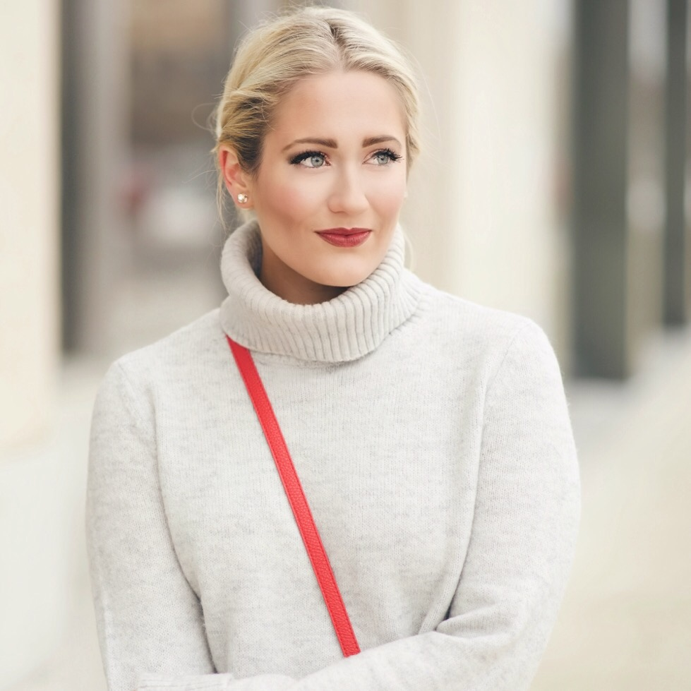 Grey turtleneck sweater with red lips and red crossbody bag