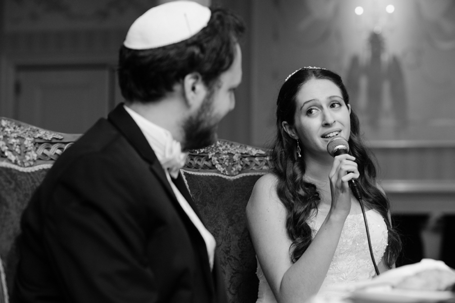 Bride-Sings-to-Groom-at-wedding