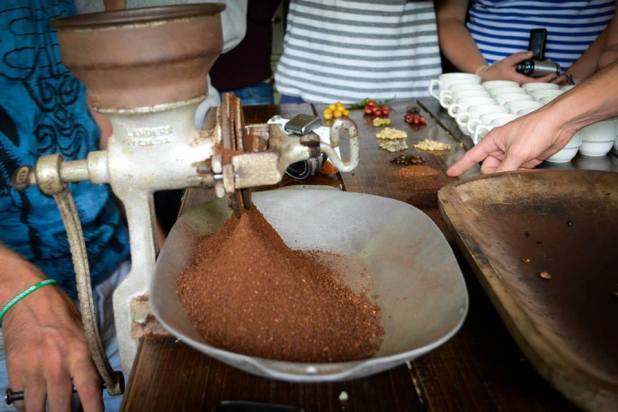 Grinding the beans.