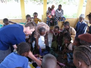 Distributing clothes I collected from friends and family at an orphanage in Kissidougou, Guinea