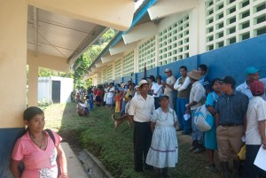 Patients wrap around one of the school houses