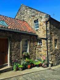 cottage with flowers in dean village edinburgh
