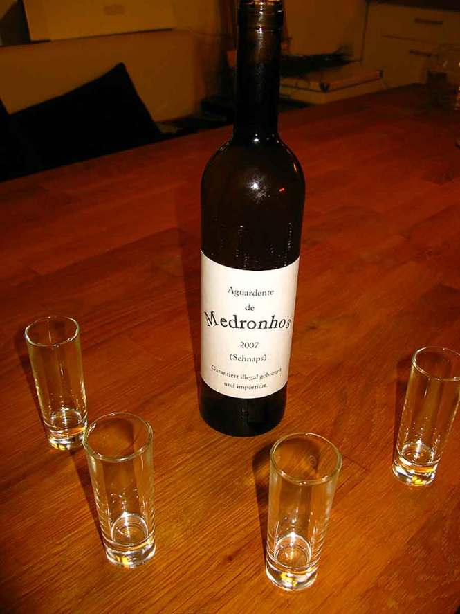 Aguardente bottle and shot glasses