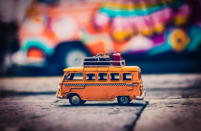 Toy bus on cobbled road